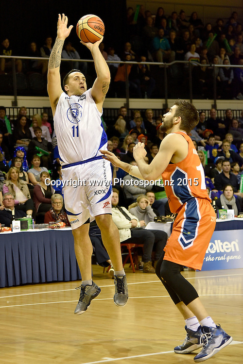 Brendon Polblank (L) of the Saints jumps to shoot with Adrian Majstrovich of the Southland Sharks during the NBL final basketball match between Wellington Saints and Southland Sharks at the TSB Arena in Wellington on Sunday the 5th of July 2015. Copyright photo by Marty Melville / www.Photosport.nz