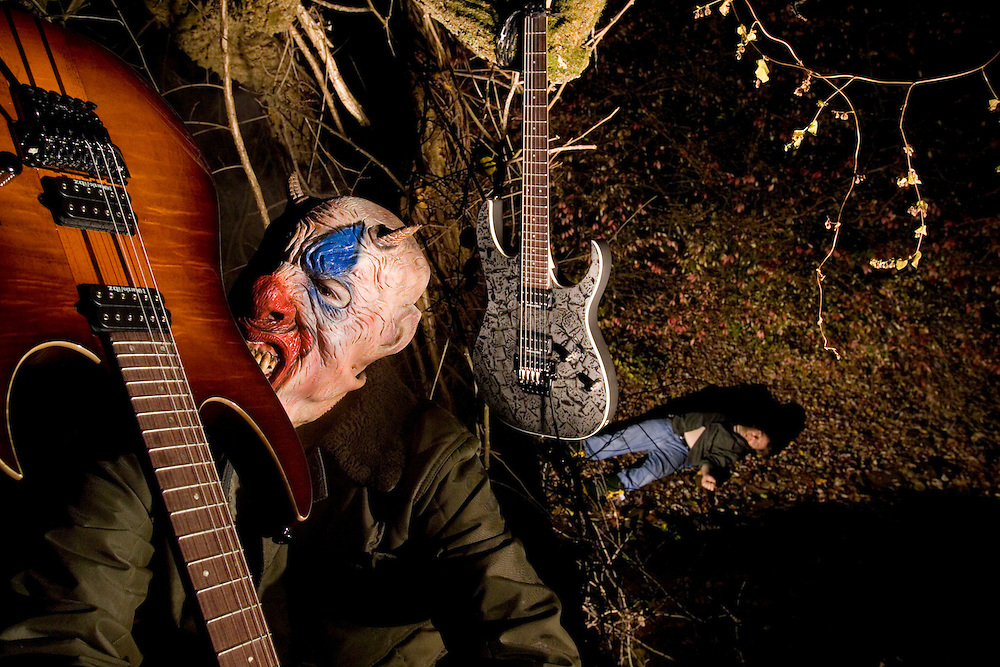 "Scene from an imaginary film, ""The Ax Murderer"". This serial killer cavorts in the dark of night while one of his victims lies in the background. Shot for Ibanez Electric guitars."