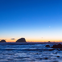 Venus and crescent moon in sunset twilight. Wilson Creek Beach, Redwoods State Park, CA