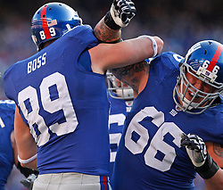 Nov 22, 2009; East Rutherford, NJ, USA; New York Giants tight end Kevin Boss (89) and New York Giants offensive tackle David Diehl (66)  celebrate Boss' touchdown catch during the first half at Giants Stadium. Mandatory Credit: Ed Mulholland