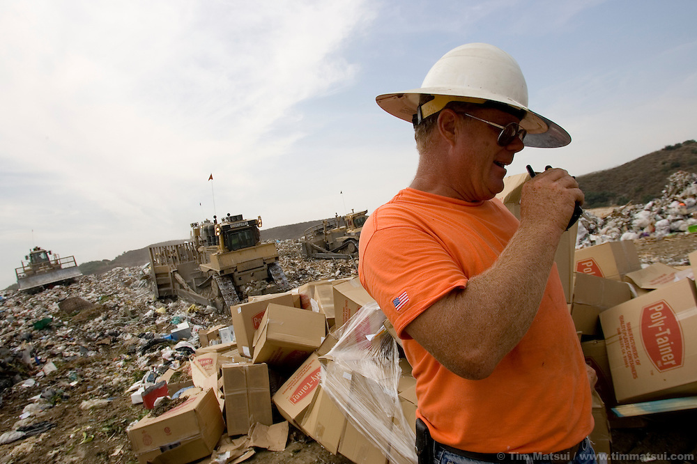 WEDNESDAY JULY 26, 2006 - LOS ANGELES, CALIF.  Trash inspector Richard Gemmrig makes sure no hazardous waste is dumped in the active fill area of the Frank R. Bowerman Landfill near Los Angeles in Orange County, Calif. The landfill naturally produces methane gas from trash decomposition and Seattle-based Prometheus is installing a 5000 gallon per-day methane gas liquifying facility. Prometheus will liquify and sell the methane gas for transportation, heating, and industry. The gas is naturally produced by the landfill.