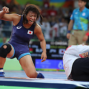 Wrestling - Olympics: Day 13  Risako Kawai of Japan celebrates her gold medal victory by throwing her coach, Kazuhito Sakae of Japan after her gold medal victory against Maryia Mamashuk of Belarus in the Women's Freestyle 63 kg Gold Medal match at the Carioca Arena 2 on August 18, 2016 in Rio de Janeiro, Brazil. (Photo by Tim Clayton/Corbis via Getty Images)