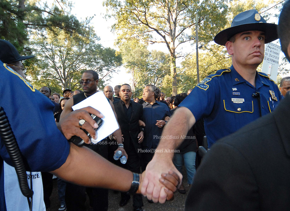 Louisiana Stae police hold hands to form a barrier between the media and Reverend Al Sharpton, center, who leads a group of supporters of the so-called Jena Six during a march past Jena Highschool in Jena, Louisiana, U.S., on Thursday, Sept. 20, 2007. Thousands of people gathered to support the black teenagers who had been charged with attempted murder in the beating of a white classmateReverend Al Sharpton, center, leads a group of supporters of the so-called Jena Six during a march past Jena Highschool in Jena, Louisiana, U.S., on Thursday, Sept. 20, 2007. Thousands of people gathered to support the black teenagers who had been charged with attempted murder in the beating of a white classmate(Photo/© Suzi Altman)