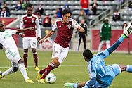 March 30th, 2013 Commerce City, CO - Colorado Rapids midfielder Tony Cascio (14) attempts to get past the defense by Portland Timbers goalkeeper Donovan Ricketts (1) in the second half of the MLS match between the Portland Timbers and the Colorado Rapids at Dick's Sporting Goods Park in Commerce City, CO