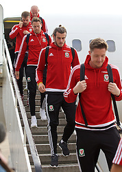 CARDIFF, WALES - Sunday, October 11, 2015: Wales' Gareth Bale steps off the team plane as the squad return to Cardiff Airport after qualifying for UEFA Euro 2016 after the UEFA Euro 2016 qualifying match against Bosnia and Herzegovina. (Pic by David Rawcliffe/Propaganda)