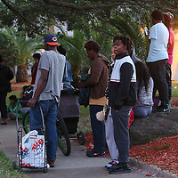 Residents waited for hours as law enforcement officers searched for murder suspect Markeith Loyd at the Tzadik Brookside Apartments on January 9 2017 in Orlando, Florida. Loyd shot an Orlando Police officer earlier in the day at a local Walmart, the officer has since died.  (Alex Menendez via AP)