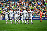 The New England Revolution celebrate after a goal while Stefan Frei #24 of Seattle Sounders watches during a MLS soccer match on Saturday, Aug. 10, 2019, in Seattle. The teams played tp a 3-3 tie. (Alika Jenner/Image of Sport)