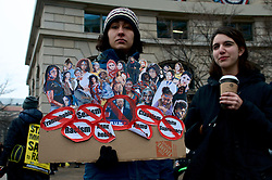 Protests gather at US Navy Memorial Plaza, in Washington, D.C. ahead of the January 20, 2017 Inauguration Ceremony of Donald J Trump as the 45th President of the United States.