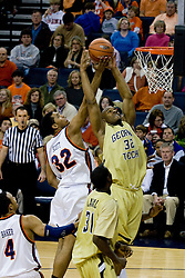 Virginia forward Mike Scott (32) and Georgia Tech forward Jeremis Smith (32) battle for a rebound.  The Virginia Cavaliers men's basketball team fell to the Georgia Tech Yellow Jackets 92-82 in overtime at the John Paul Jones Arena in Charlottesville, VA on January 27, 2008.