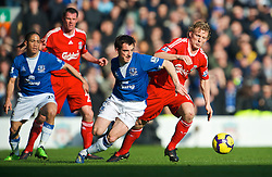 LIVERPOOL, ENGLAND - Saturday, February 6, 2010: Liverpool's Dirk Kuyt and Everton's Leighton Baines during the Premiership match at Anfield. The 213th Merseyside Derby. (Photo by: David Rawcliffe/Propaganda)