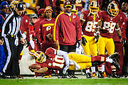 Washington Redskins quarterback Robert Griffin III dives for yardage along the slideline during first quarter action at FedEx Field during the NFC Wild Card round in Landover, Maryland on January 6, 2013. The Redskins lead the Seahawks 14-13 at Halftime. UPI/Pete Marovich