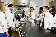 01/30/2014 - Boston, Mass. - Adjunct instructor Jack Tsai, M06, explains to students the functions of the Elekta Axesse linear accelerator, which is used for radiation treatment for cancer patients, at Tufts Medical Center on Jan. 30, 2014. (Kelvin Ma/Tufts University)