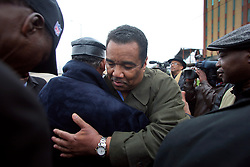 02 March 2010. New Orleans, Louisiana, USA. <br /> Civil Rights leaders gather at the notorious Danziger Bridge in New Orleans East, scene of the Sunday Sept 4th, 2005 murder of 40 yr old Ronald Madison and 19 yr old James Brissette by New Orleans police. <br /> Reverend Dr Norwood Thompson Jr embraces Doctor Romell Madison (center frame), brother of victim Ronald Madison as they pray following  their address to the media.<br /> The police are under federal investigation for an alleged cover up of the botched killings in the chaotic aftermath of hurricane Katrina. <br /> Photo; Charlie Varley.