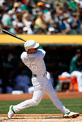 OAKLAND, CA - AUGUST 25: Matt Chapman #26 of the Oakland Athletics ta bat against the San Francisco Giants during the first inning at the RingCentral Coliseum on August 25, 2019 in Oakland, California. The San Francisco Giants defeated the Oakland Athletics 5-4. Teams are wearing special color schemed uniforms with players choosing nicknames to display for Players' Weekend. (Photo by Jason O. Watson/Getty Images) *** Local Caption *** Matt Chapman