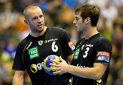 Grzegorz Tkaczyk (#6) of RNL and Uwe Gensheimer (#3) of RNL during Velux EHL Champions league 2010/2011 Group A men handball match between HC Celje Pivovarna Lasko of Slovenia and Rhein-Neckar Loewen of Germany, on October 2, 2010 in Arena Zlatorog, Celje, Slovenia. Rhein-Neckar Löwen defeated Celje Pivovarna Lasko 32 - 28. (Photo By Vid Ponikvar / Sportida.com)