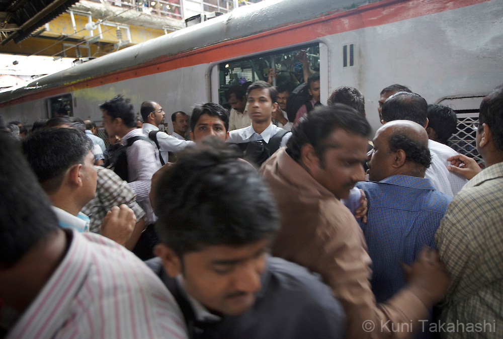 Morning commuters rush getting on and out of train at Dadar station in Mumbai, India on September 11, 2012.<br /> (Photo by Kuni Takahashi)
