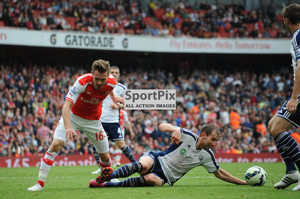 Arsenals Aaron Ramsey and West Broms Gareth McAuley in action during the Arsenal v West Brom match on Sunday 24th May 2015