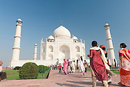 Taj Mahal, Agra, India - November 18, 2010: The Taj Mahal is India most popular destination for local and international tourists. It was built by Shah Jahan as a memorial to his wife and is the most outstanding example of Mughal architecture built from white marble.