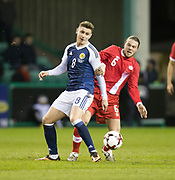 Scotland&rsquo;s Tom Cairney and Canada&rsquo;s Samuel Piette - Scotland v Canada, friendly international at EasterRoad, Edinburgh.Photo: David Young<br /> <br />  - &copy; David Young - www.davidyoungphoto.co.uk - email: davidyoungphoto@gmail.com