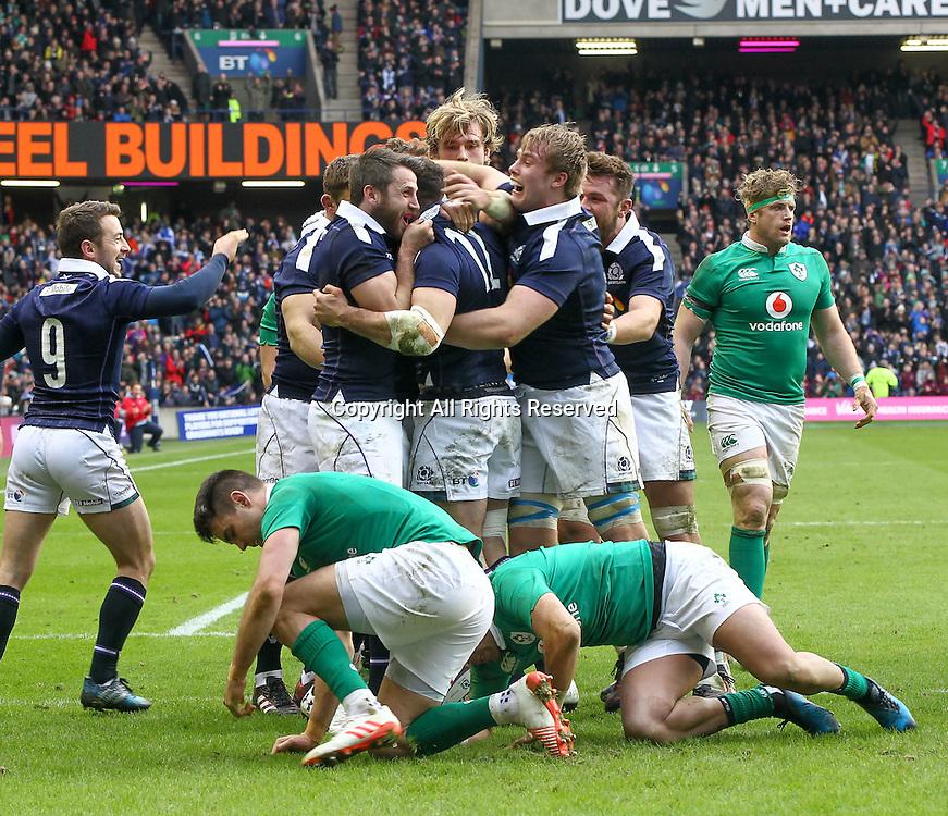 February 4th 2017, Murrayfield, Edinburgh, Scotland; 6 Nations International rugby, Scotland versus Ireland;  Scotlands centre Alex Dunbar is congratulated on his try by team-mates Greig Laidlaw Jonny Gray and Jonny Gray