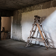 A ladder in a guesthouse under construction in the village of Abano in the Truso Valley, near the border with occupied territory of South Ossetia in the Mtskheta-Mtianeti region of Georgia.  The entire valley is all but abandoned, and for most of the year is home only to a lone homesteader, a monk, and four nuns and a priest who live in a small abbey. The building is a project of the abbey, and is intended to provide a place for visitors to stay.
