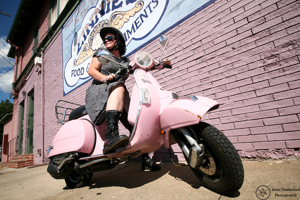 Erica Bodine rocks her pink scooter in midtown Memphis, TN.