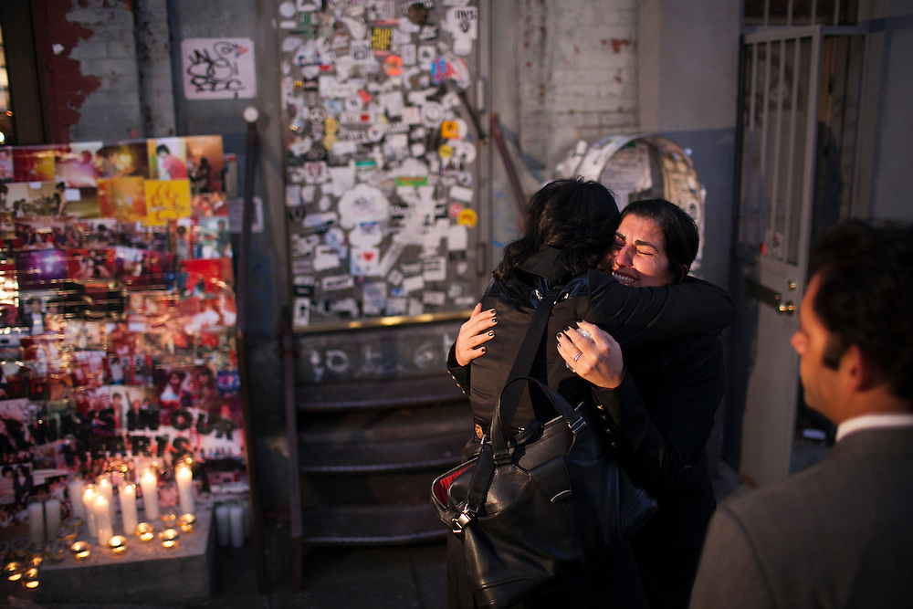 Mourners embrace at a candlelight vigil for the Yellow Dogs, the band whose members were killed last week, at Cameo Gallery, 93 North 6th Street in the Williamsburg neighborhood of Brooklyn, NY on Monday, Nov. 18, 2013.<br /> <br /> Photograph by Andrew Hinderaker