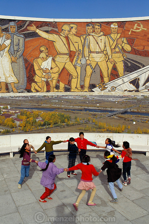 One of the monuments honoring Soviet accomplishments in days gone by in Ulaan Baatar, Mongolia built on a little peak named Zaisan. It's still a popular site for visitors because of the good view over the city. School children visit and play. Material World Project.
