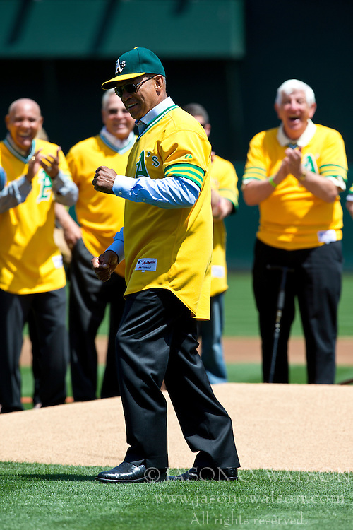 OAKLAND, CA - APRIL 27:  Hall of Fame baseball player reacts after throwing the ceremonial first pitch before the game between the Oakland Athletics and the Baltimore Orioles at O.co Coliseum on April 27, 2013 in Oakland, California. The Baltimore Orioles defeated the Oakland Athletics 7-3. (Photo by Jason O. Watson/Getty Images) *** Local Caption *** Reggie Jackson
