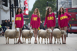 © licensed to London News Pictures. London, UK 11/10/2012. M&S models posing with a flock of sheep in Oxford Street in support of The Campaign for Wool's Week. M&S calling on the British public to 'shwop' unwanted woollen items to be reused, recycled or resold through the M&S and Oxfam partnership. Photo credit: Tolga Akmen/LNP