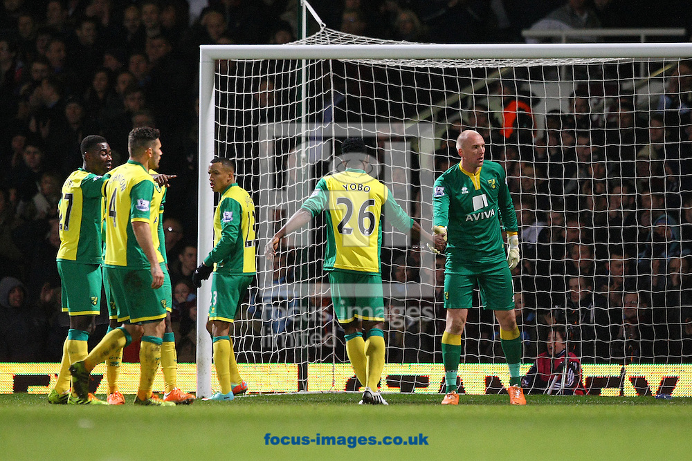Picture by Paul Chesterton/Focus Images Ltd +44 7904 640267<br /> 11/02/2014<br /> Joseph Yobo of Norwich congratulates John Ruddy of Norwich after he made a great save during the Barclays Premier League match at the Boleyn Ground, London
