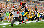 PITTSBURGH, PA - SEPTEMBER 28: Wide Receiver Mike Evans #13 of the Tampa Bay Buccaneers during the game against the Pittsburgh Steelers at Heinz Field on September 28, 2014, in Pittsburgh, Pennsylvania. The Buccaneers won 27-24. (photo by Mike Carlson/Tampa Bay Buccaneers)