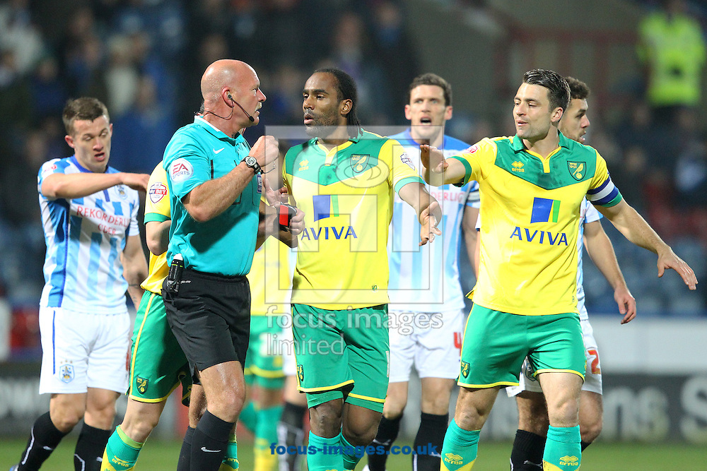 Cameron Jerome of Norwich leads the protests to Referee Nigel Miller after Bradley Johnson of Norwich's &quot;goal&quot; is disallowed during the Sky Bet Championship match at the John Smiths Stadium, Huddersfield<br /> Picture by Paul Chesterton/Focus Images Ltd +44 7904 640267<br /> 17/03/2015