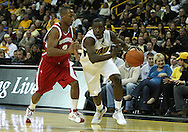 21 JANUARY 2009: Iowa's Jermain Davis (23) gets around Wisconsin's Trévon Hughes (3) during the first half of an NCAA college basketball game Wednesday, Jan. 21, 2009, at Carver-Hawkeye Arena in Iowa City, Iowa. Iowa defeated Wisconsin 73-69 in overtime.