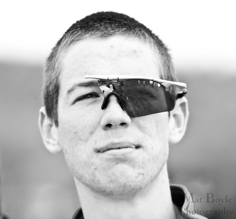 A member of the Rowan ultimate team poses with a pair of broken sunglass left on the field during the regional tournament.