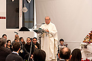 "ROME, ITALY -  DECEMBER 24:  Mons. Enrico Feroci director of Caritas Rome during  Christmas Mass at the hostel ""Don Luigi Di Liegro"" to Termini Station, with the  guests of Caritas on December 24, 2016 in Rome, Italy. (Photo by Stefano Montesi/Corbis via Getty Images)"
