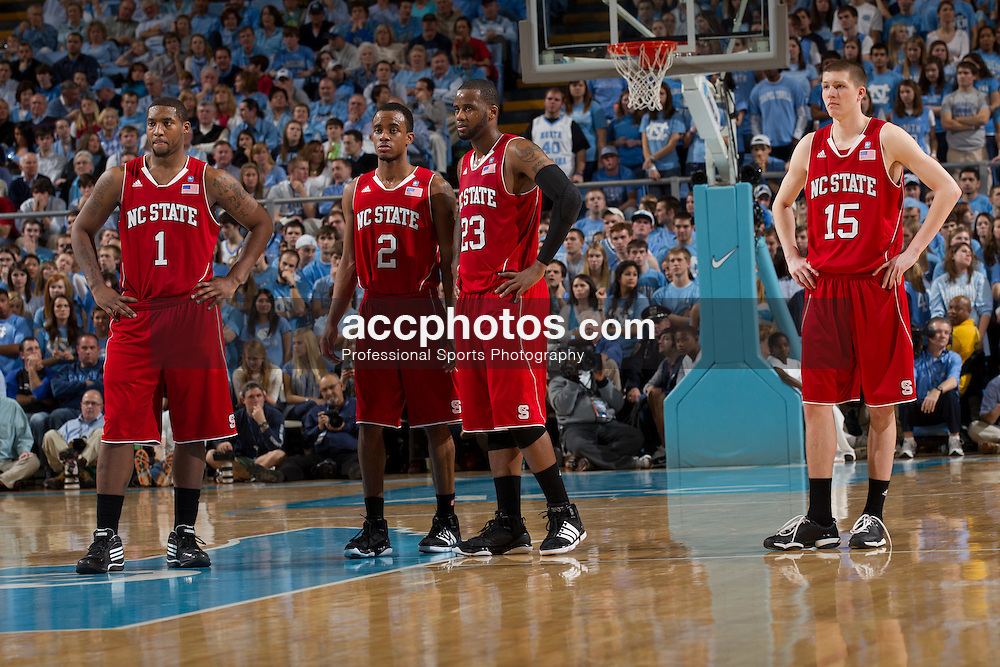 CHAPEL HILL, NC - JANUARY 29: Richard Howell #1, Lorenzo Brown #2, Tracy Smith #23 and Scott Wood #15 of the North Carolina State Wolfpack watch as a foul shot is taken while playing against the North Carolina Tar Heels on January 29, 2011 at the Dean E. Smith Center in Chapel Hill, North Carolina. North Carolina won 84-64. (Photo by Peyton Williams/UNC/Getty Images)  *** Local Caption *** Richard Howell;Lorenzo Brown;Tracy Smith;Scott Wood