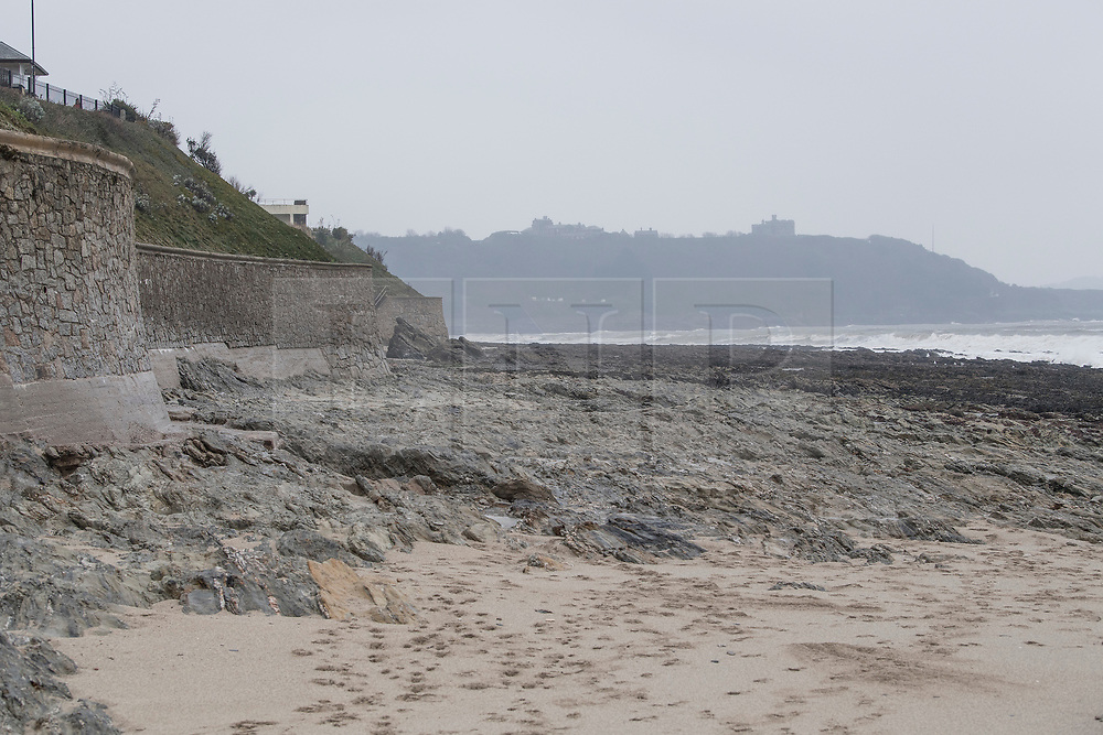 © Licensed to London News Pictures. 02/03/2018. FALMOUTH CORNWALL, UK. Beach is washed away. Storm Emma caused damage to the beaches and businesses of Falmouth at the morning high spring tide today. The strong wind and the spring tide caused a beach to be washed away at Gylly beach. At Swanpool beach the beach was washed onto the road causing it to be blocked .  Photo credit: MARK HEMSWORTH/LNP