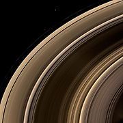 From on high, the Cassini spacecraft spies a group of three ring moons in their travels around Saturn.