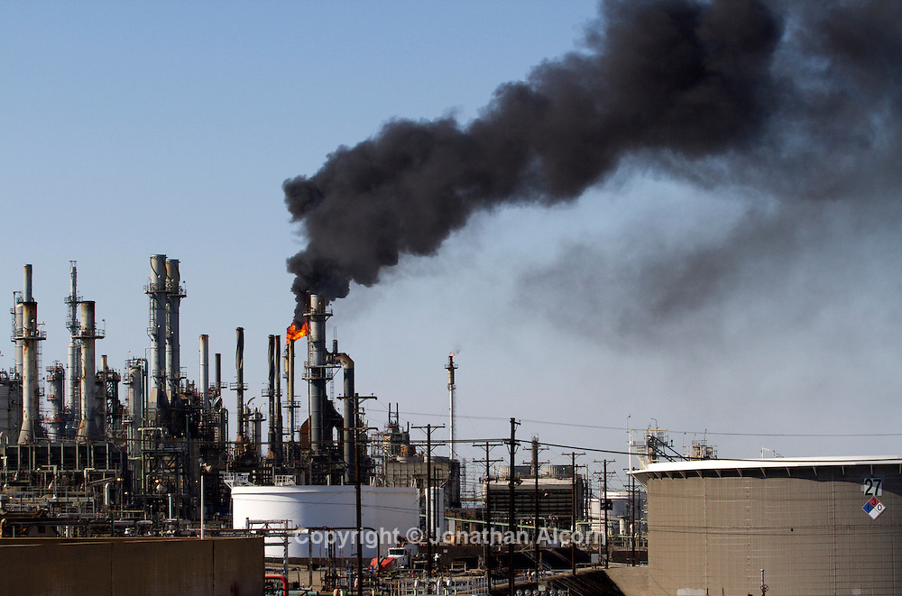 Black smoke from a flair fills the air as the ConocoPhilips Refinery in the Wilmington section of Los Angeles performed a non- emergency burn-off caused by a power outage and that shut down the oil refinery. The incident did not require a response from emergency personnel according to fire department officials.