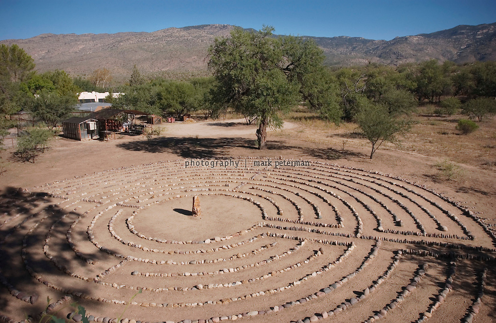The Labyrinth at ranch of Dr. Andrew Weil south of Tucson, Arizona. Last spring, Dr Weil and two of his gardeners built a stone labyrinth that sits behind the greenhouse on his ranch property just south of Tucson, Arizona.
