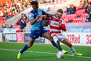 Kieran Sadlier of Doncaster Rovers battles with Joe Wright of Doncaster Rovers during the EFL Sky Bet League 1 match between Doncaster Rovers and Wycombe Wanderers at the Keepmoat Stadium, Doncaster, England on 29 February 2020.