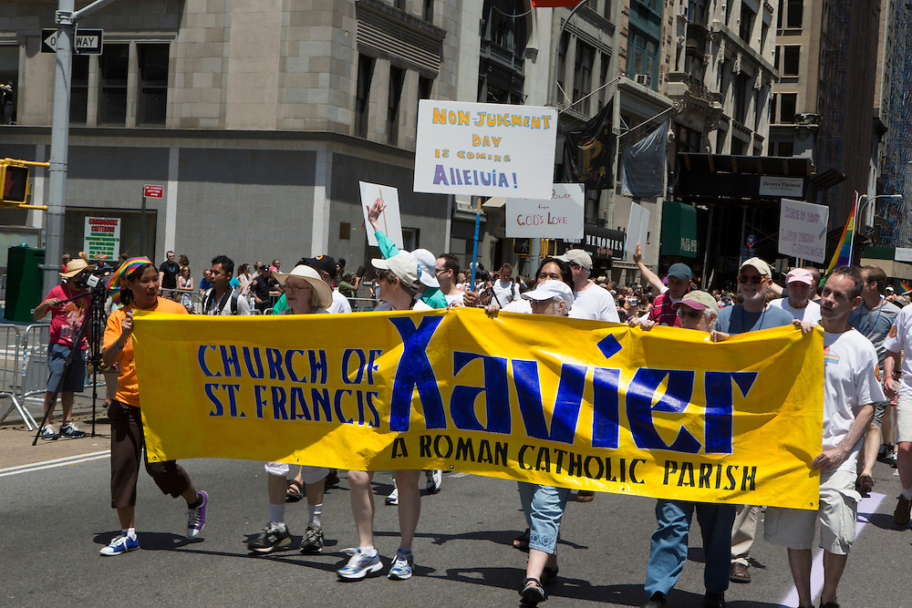 "The Roman Catholic church of St. Francis Xavier marched in support of gay rights. One member bore a sign reading ""Non-judgment day is coming! Alleluia!"""
