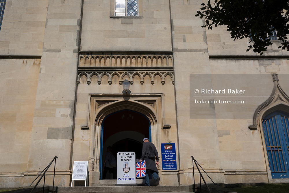 Carrying a shopping bag with the Union jack on, a churchgoer enters Windsor Baptist Church (1838), on 14th May 2018, in Windsor, London, England.