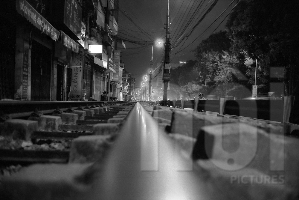Hanoi, Vietnam.2008..04 November 2008..Hanoi, Vietnam has been hit by its worst floods in 35 years.  Between Friday and Monday, more than 60 centimeters of rain paralyzed the city, causing massive damage and some twenty deaths...Railway track in LÍ Duan at night.Hai Ba Trung