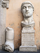 The Colossus of Constantine, an acrolithic statue that once occupied the Basilica of Maxentius in Rome. Portions of this colossal statue (A head, arm, knee and hand.) of Emperor Constantine now reside in the Palazzo dei Conservatori. Carved from white marble. Circa 312-315 AD.