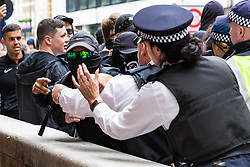 """Police and antifascist protesters clash on Portland Place as several hundred right wing protesters in central London demand the release of """"political prisoner"""" right wing talisman Stephen Yaxley-Lennon  - also known as Tommy Robinson, who was imprisoned for contempt of court. London, August 03 2019."""