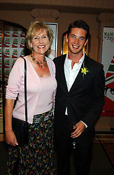 LADY TOLLEMACHE and her son the HON.JAMES TOLLEMACHE at a party to celebrate 'Made in Italy at Harrods' - a celebration of Italian fashion food and wine, design and interiors, art and photography, cinema and music, beauty and glamour.  The party was held in the Georgian Restaurant at Harrods, Knightsbridge, London on 9th September 2004.<br />