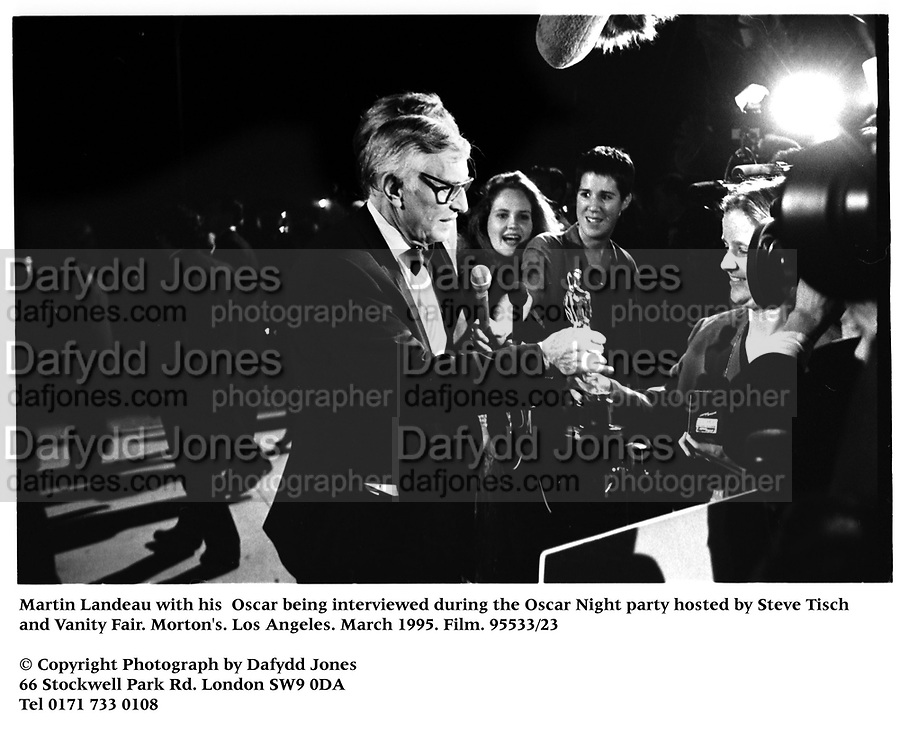 Martin Landeau with his  Oscar being interviewed during the Oscar Night party hosted by Steve Tisch and Vanity Fair. Morton's. Los Angeles. March 1995. Film. 95533/23<br />