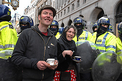 01/05/2009 G20 Protesters enjoy a cup of tea in front of a line of Police officers at the Bank of England.